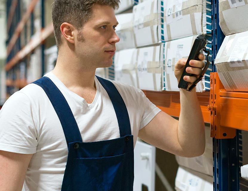 Man using stock taking handheld terminal